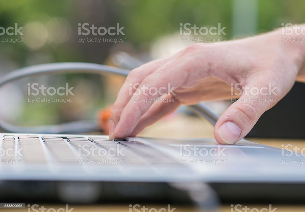 DJ using laptop outside , party and people stock photo