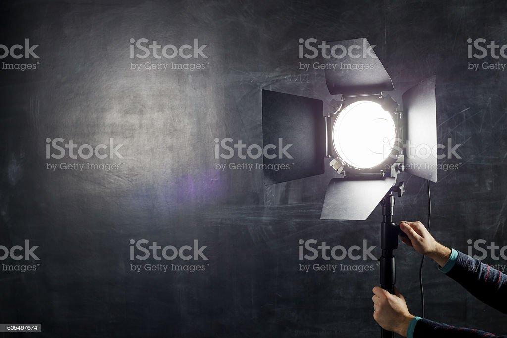 Using light equipment in photo studio stock photo