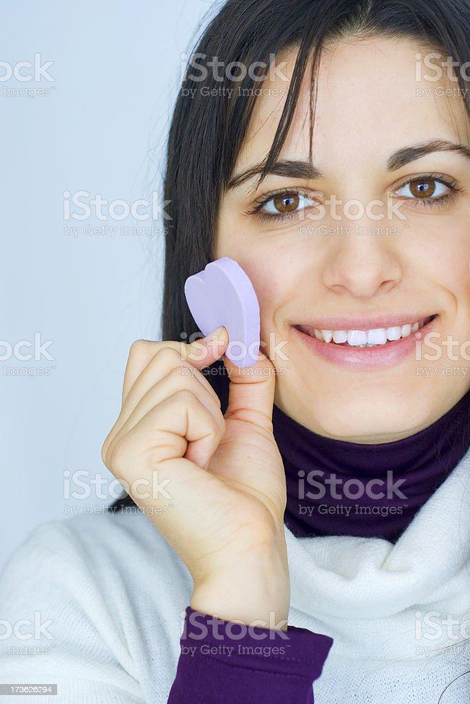 using make-up sponge in heart-shape royalty-free stock photo