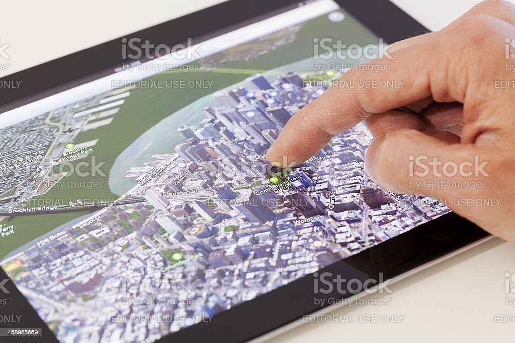 Using map app on a new iPad with iOS 6 royalty-free stock photo