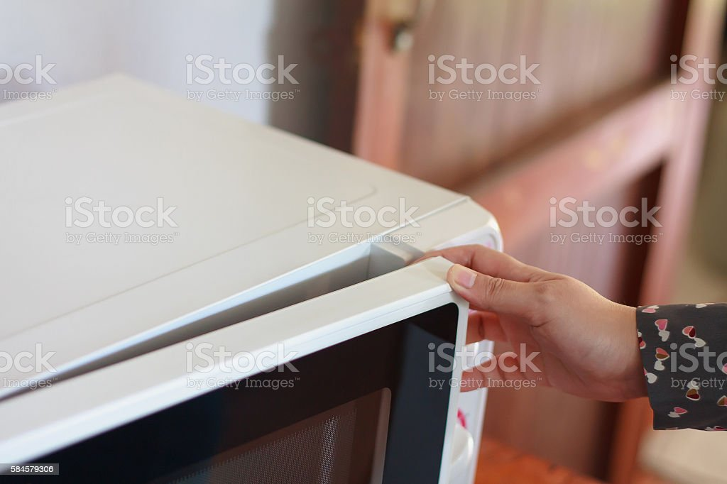 Using microwave oven stock photo