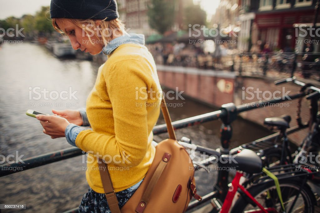 Using mobile phone outdoors stock photo