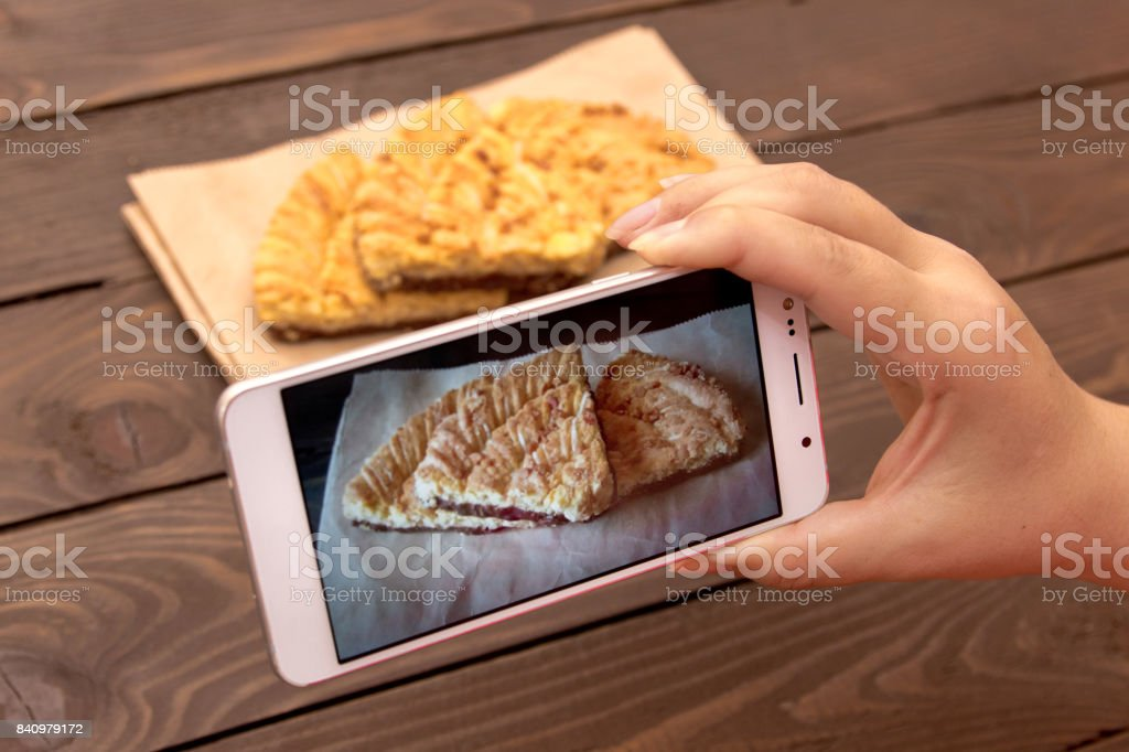 Using mobile phone to photograph the food. Photos of food for advertising or social media. stock photo