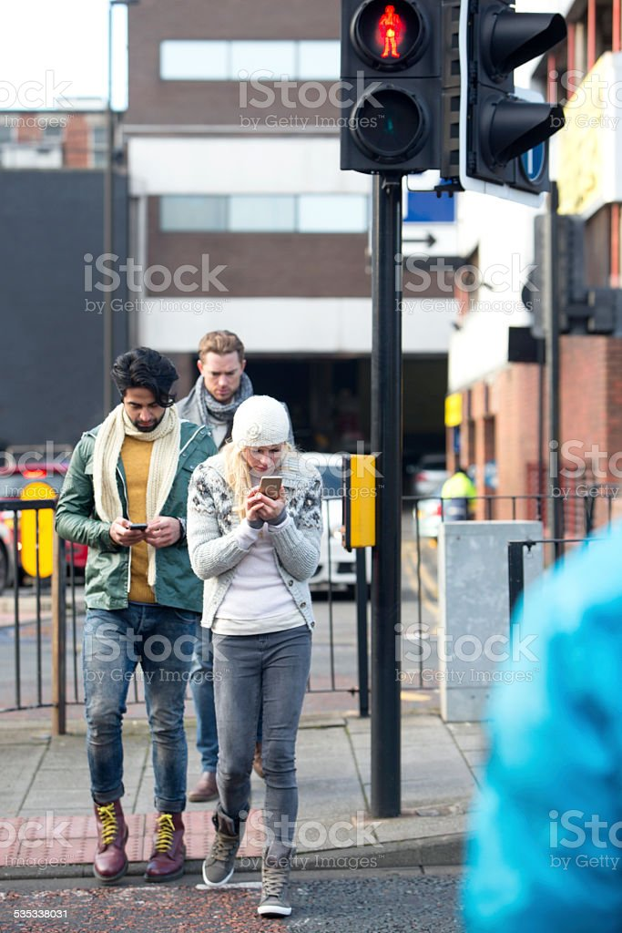 Using Mobile Telephone While Crossing A Road stock photo