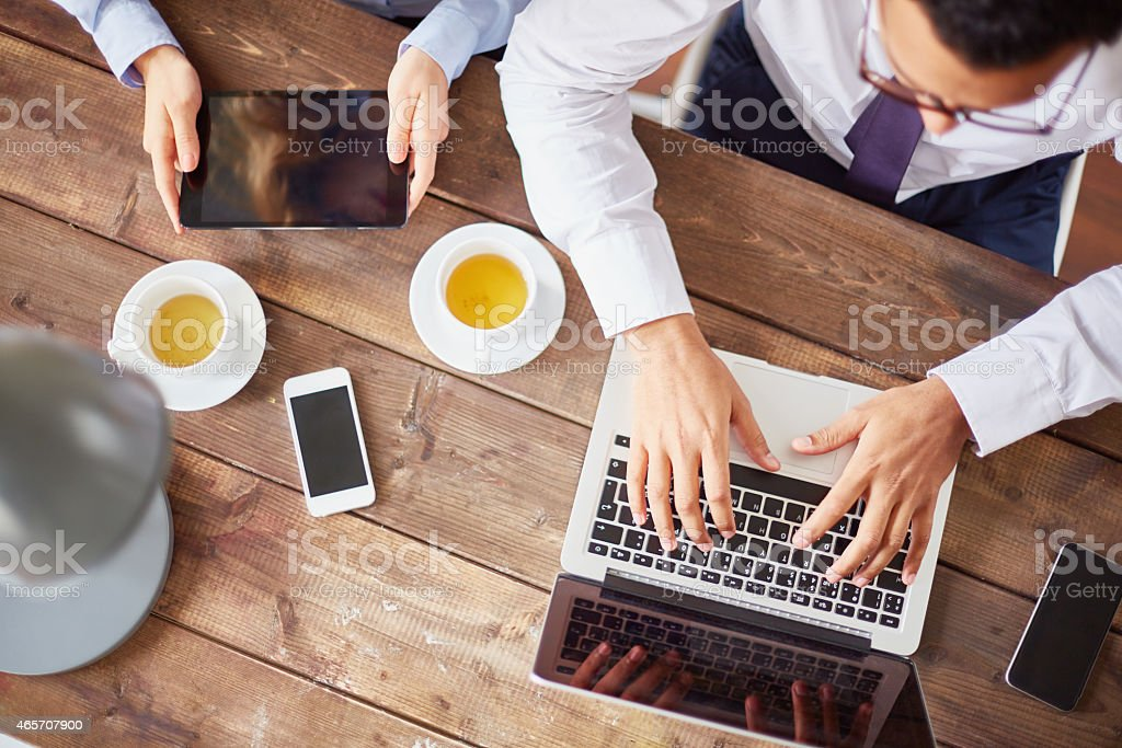 Using modern gadgets stock photo