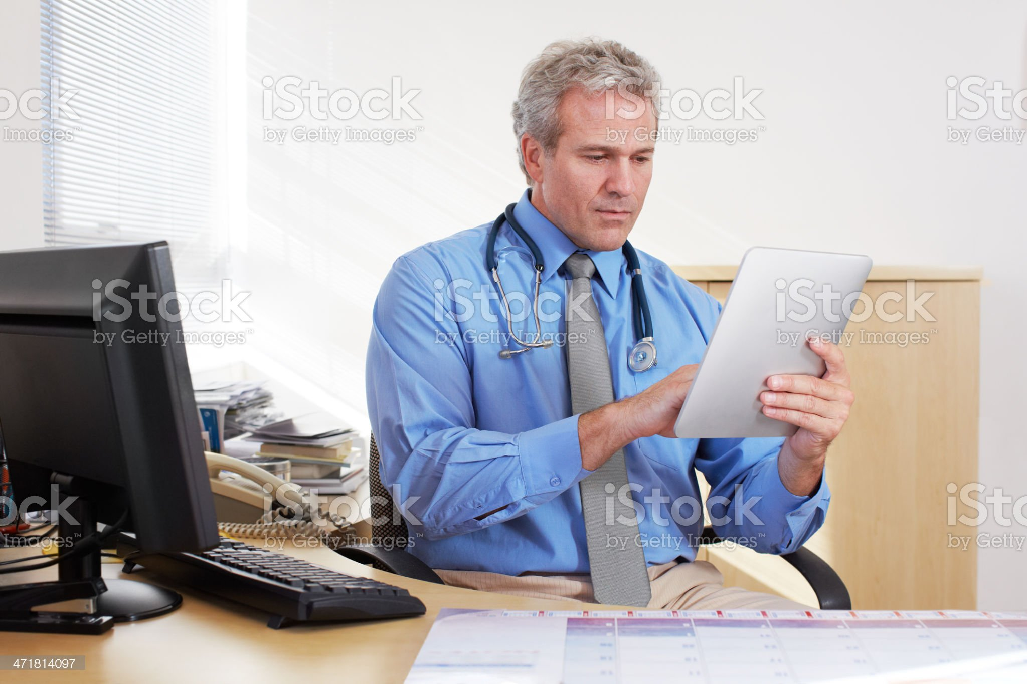 Using modern technology to aid his patient management royalty-free stock photo