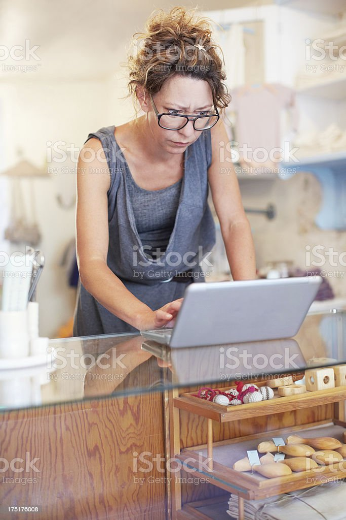 Using modern technology to boost her store royalty-free stock photo