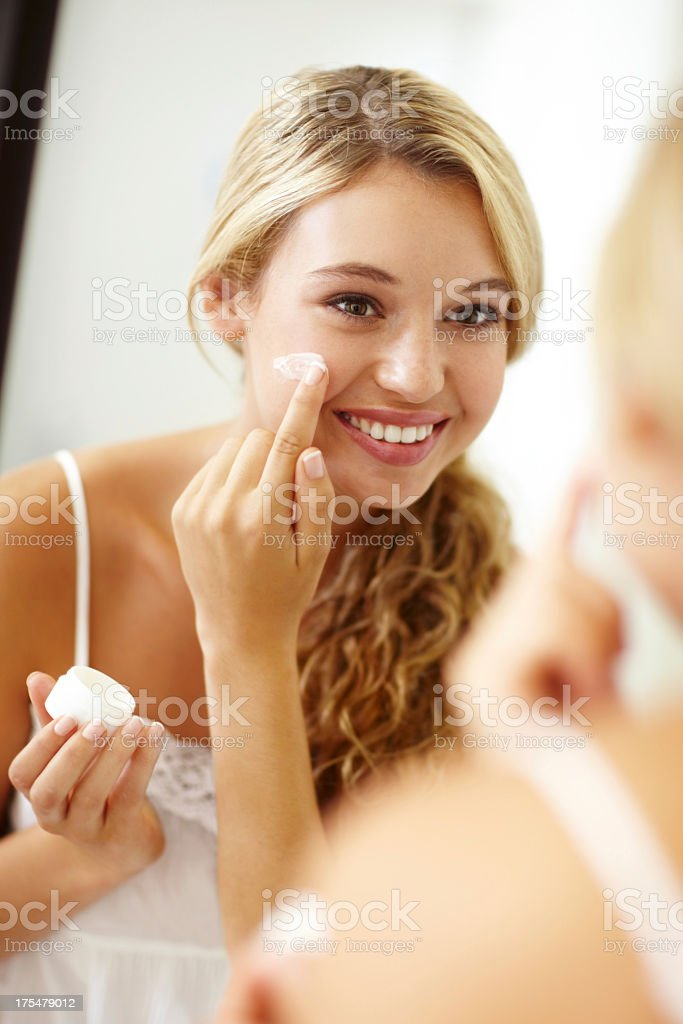 Using my favourite skincare product royalty-free stock photo
