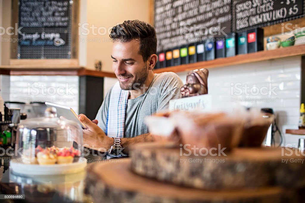Using new technology in the coffee shop stock photo