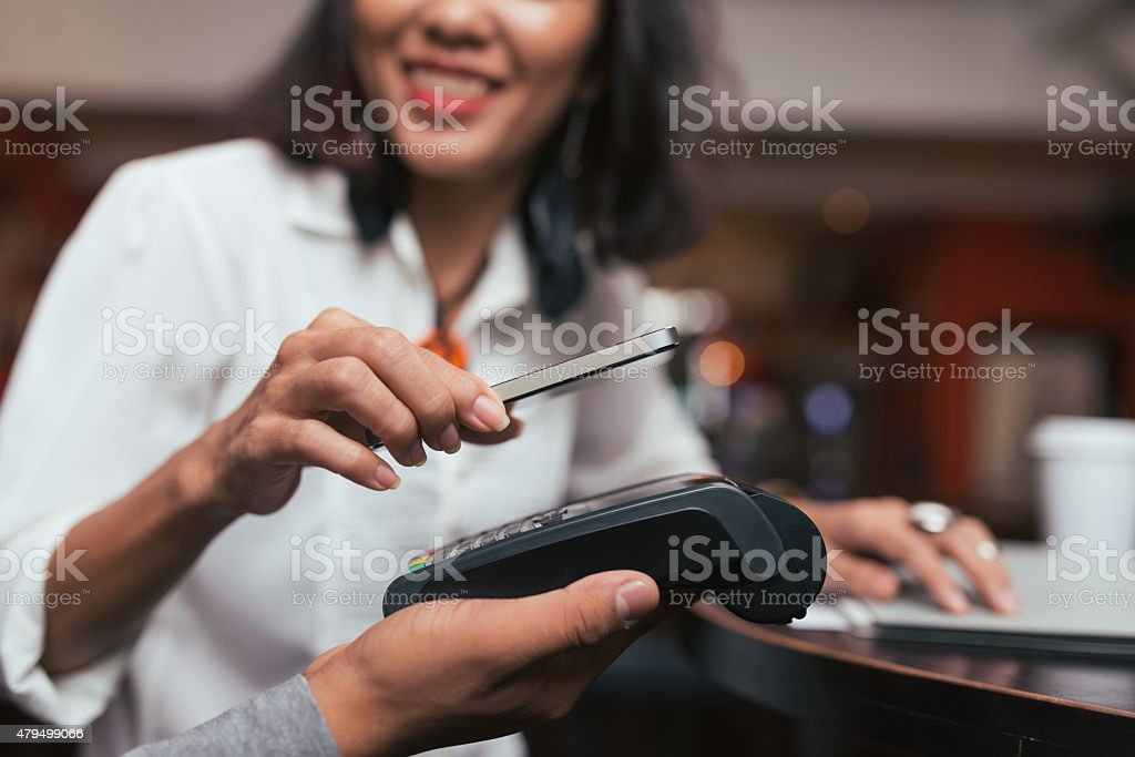 Using NFC technology to pay stock photo