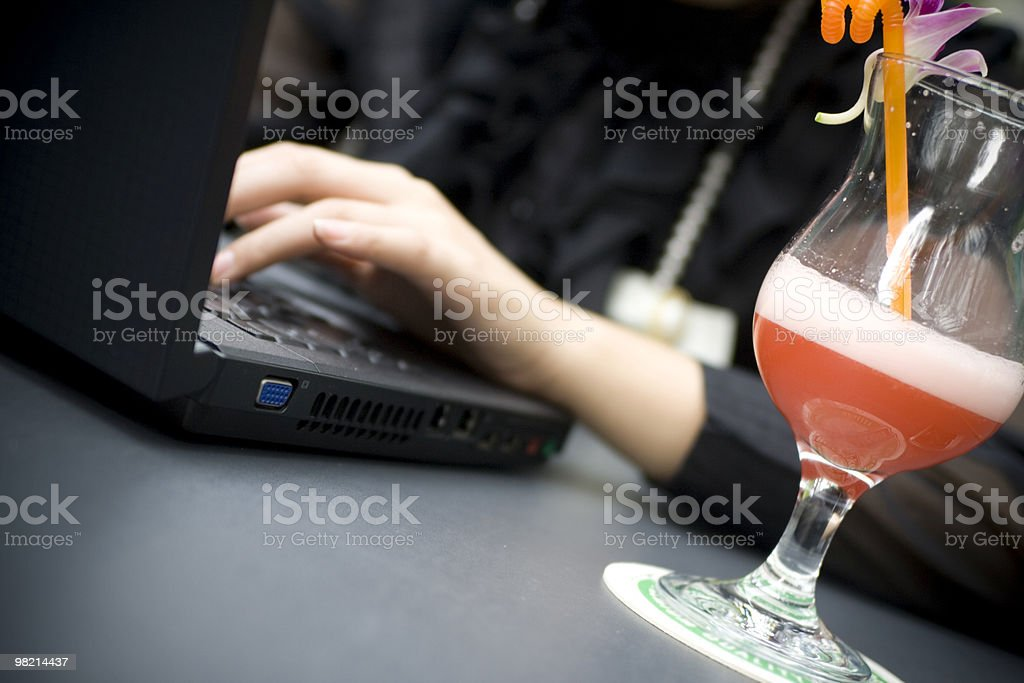 Using phone and laptop stock photo