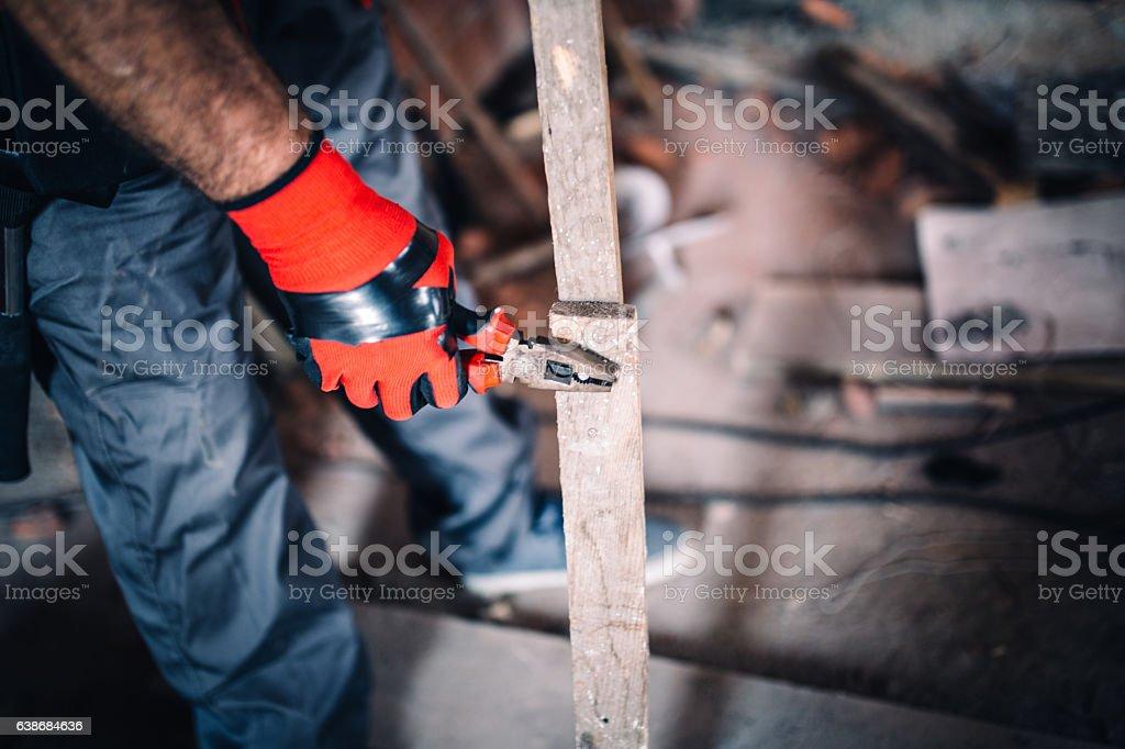 Using pliers stock photo