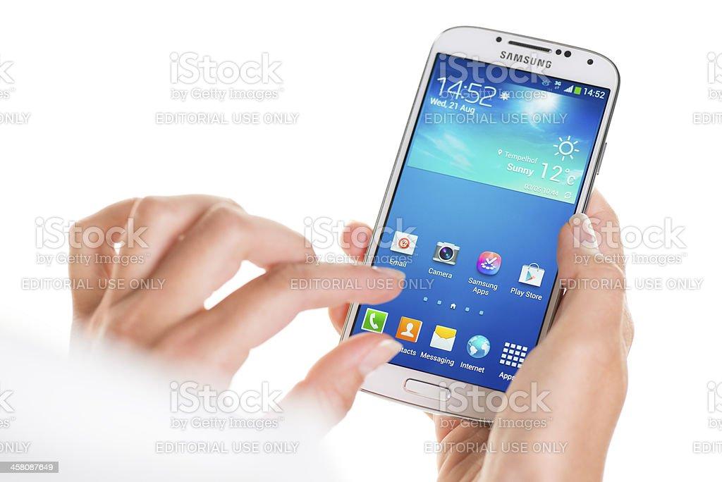 Using Samsung Galaxy S4 stock photo