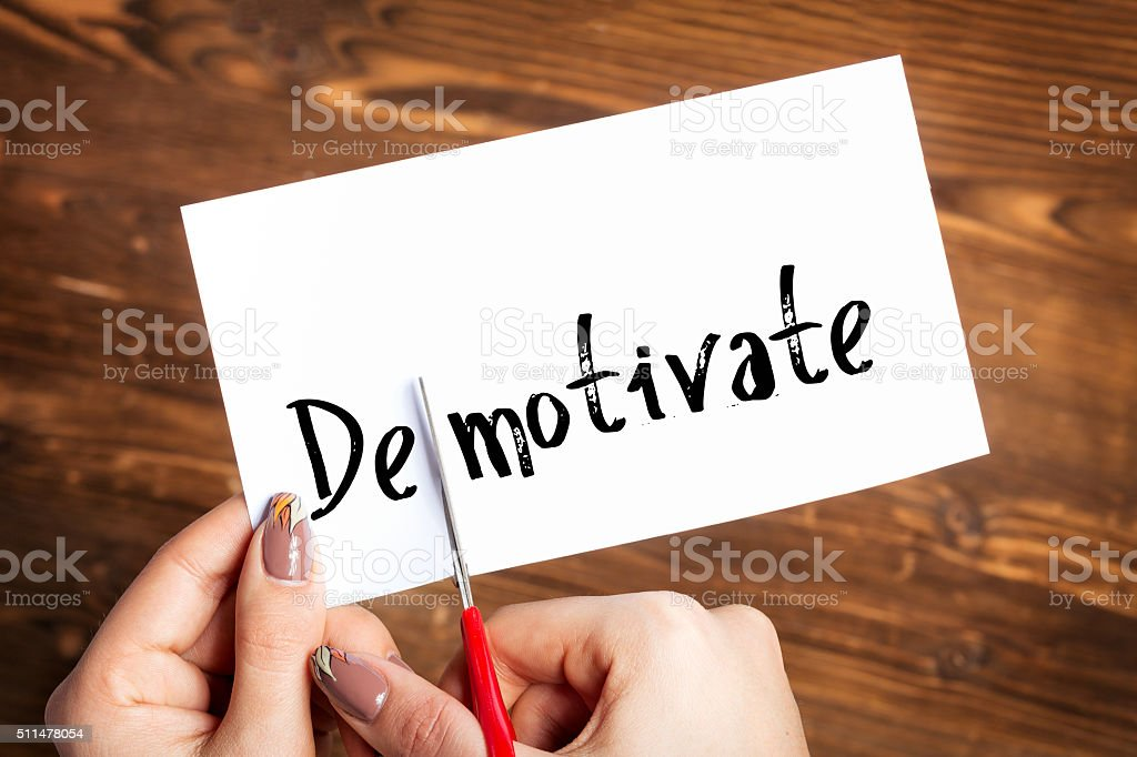 Using Scissors Cut the Word on Paper demotivate stock photo