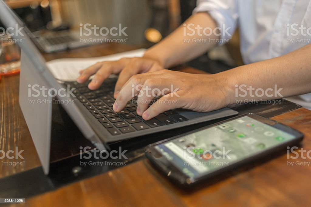 Using smart devices in work helps people save effort stock photo