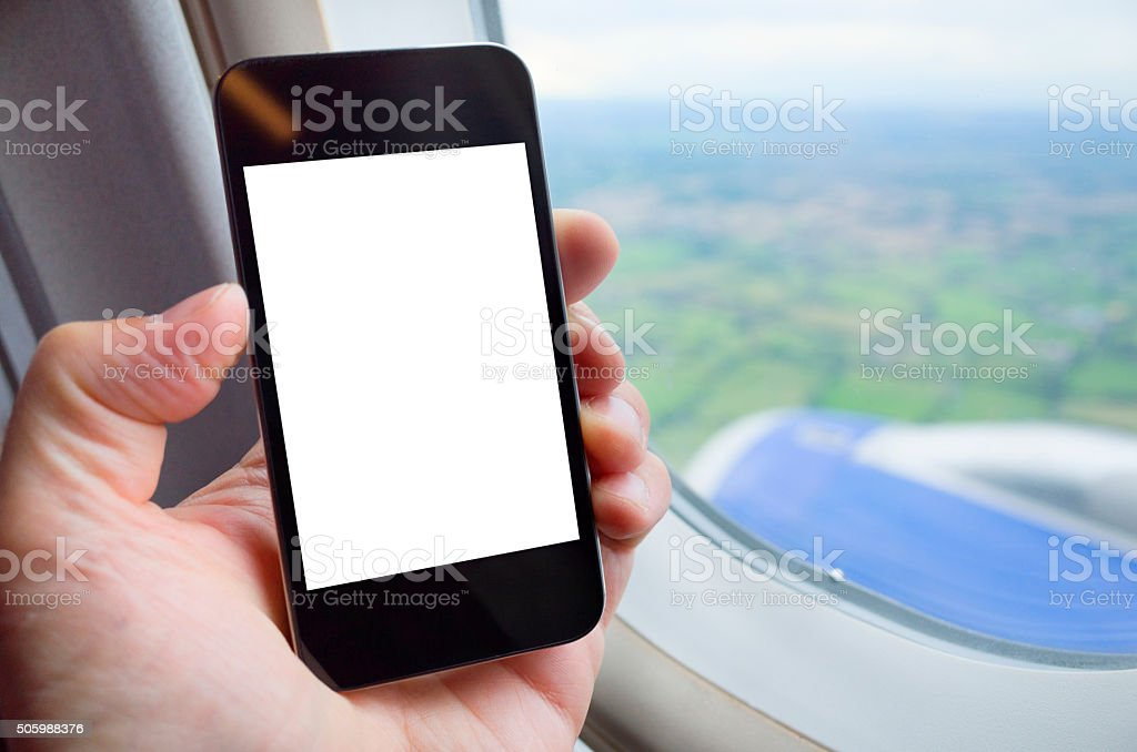Using Smart Phone App, Traveling by Air stock photo