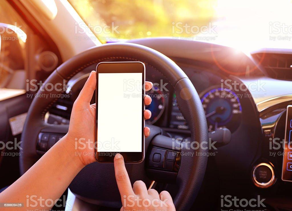 Using smart phone in car stock photo