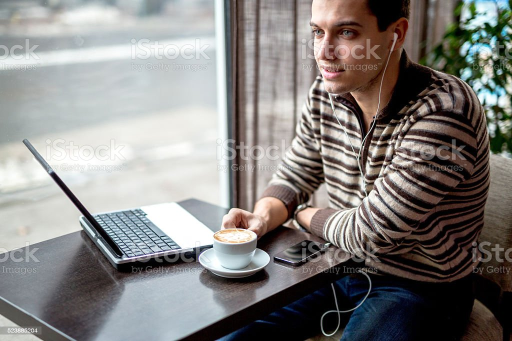 Using smartphone and drink coffee stock photo