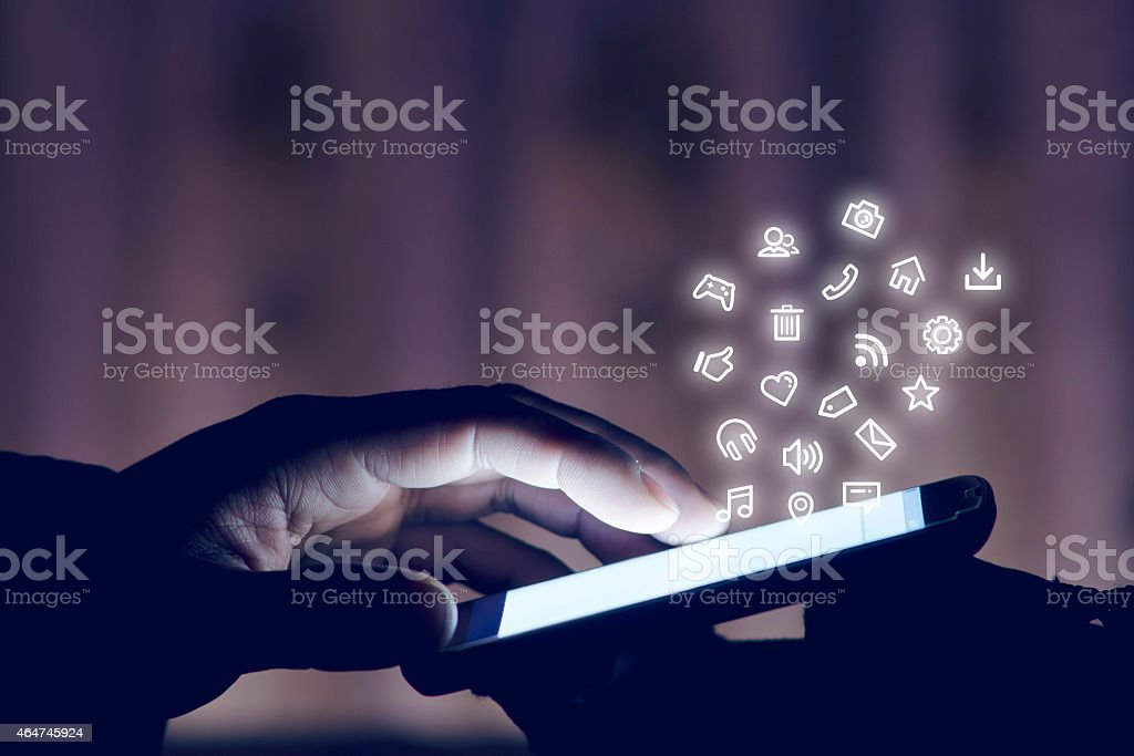 Using smartphone at night stock photo