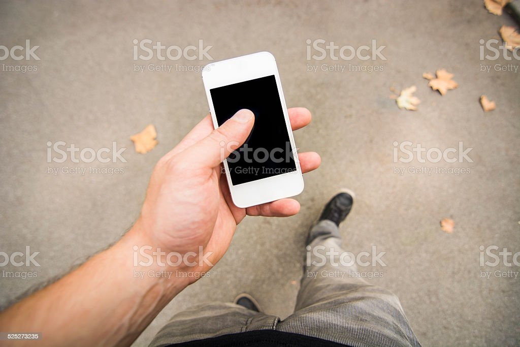 Using smartphone - First person view stock photo