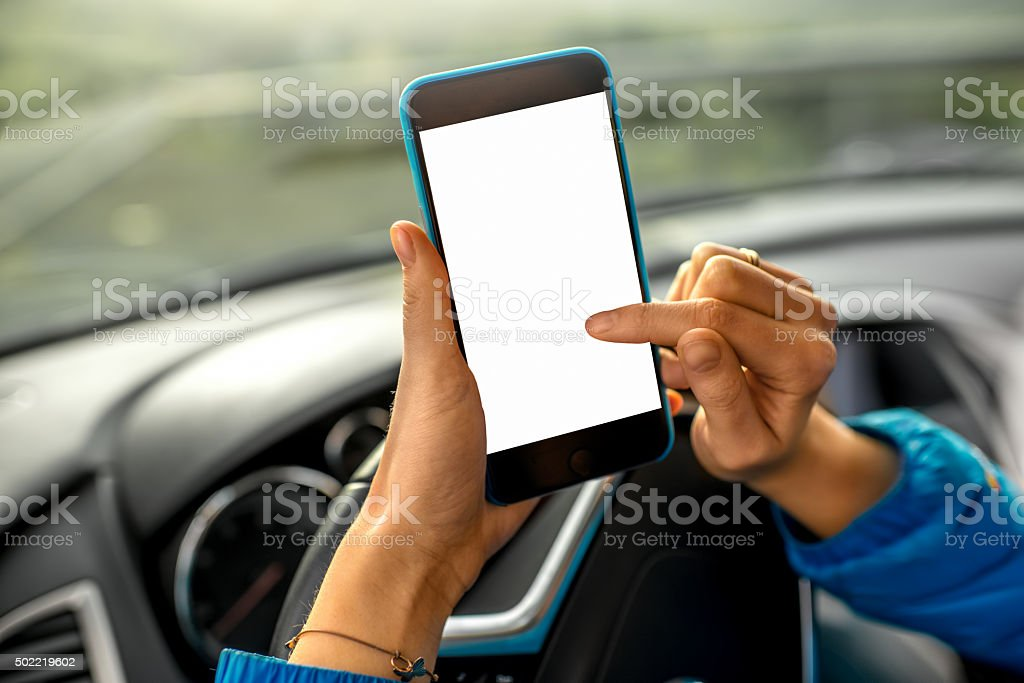 Using smartphone in the car stock photo