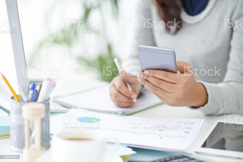 Using smartphone in work stock photo