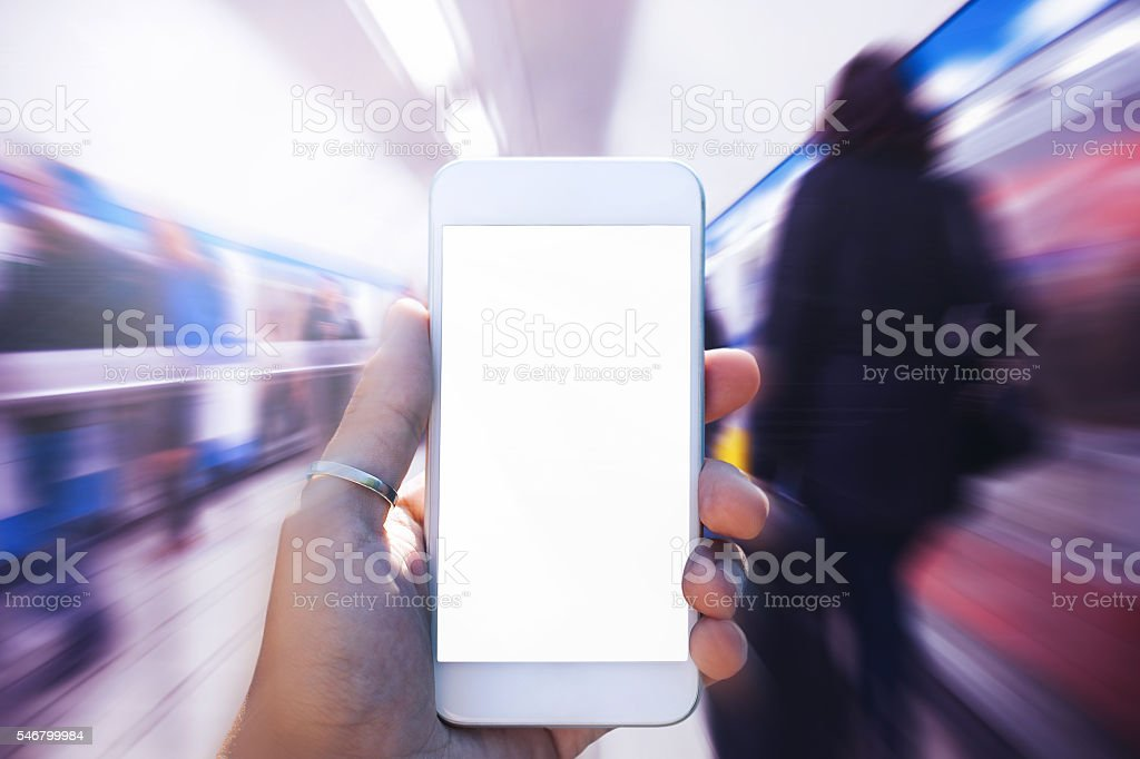 Using Smartphone on the move stock photo