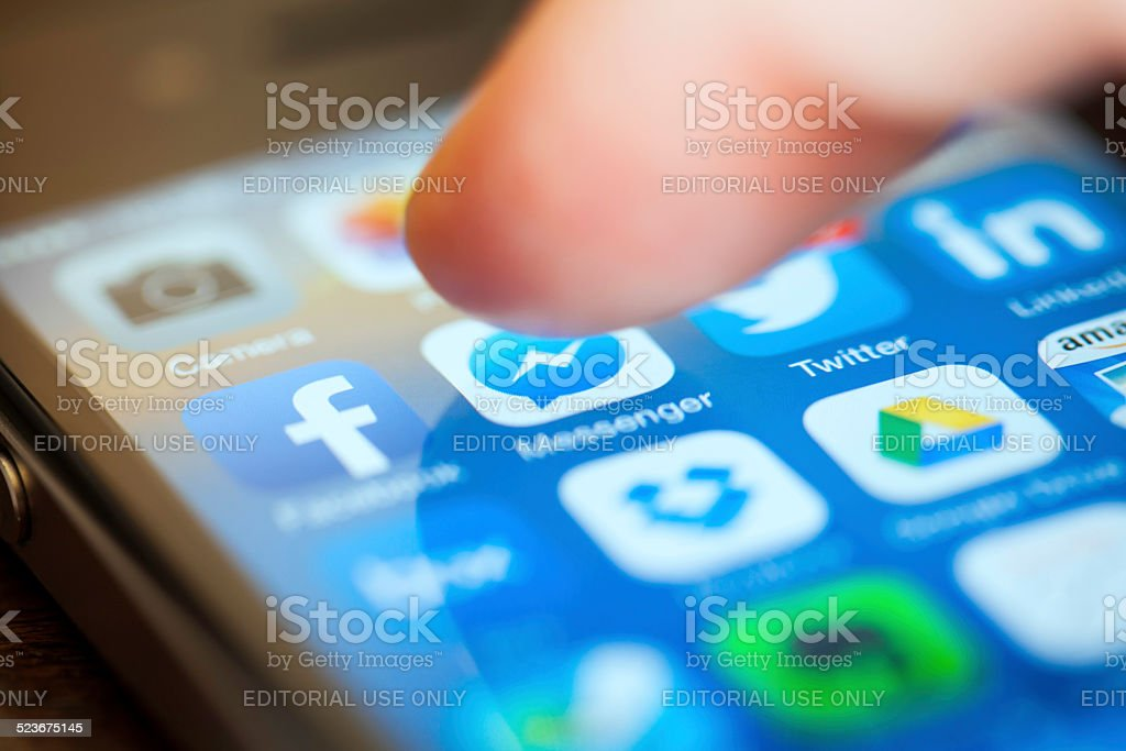 Using Social Media on iPhone stock photo