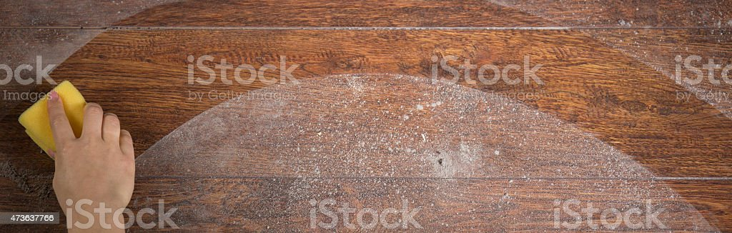 Using sponge to clean parquet stock photo