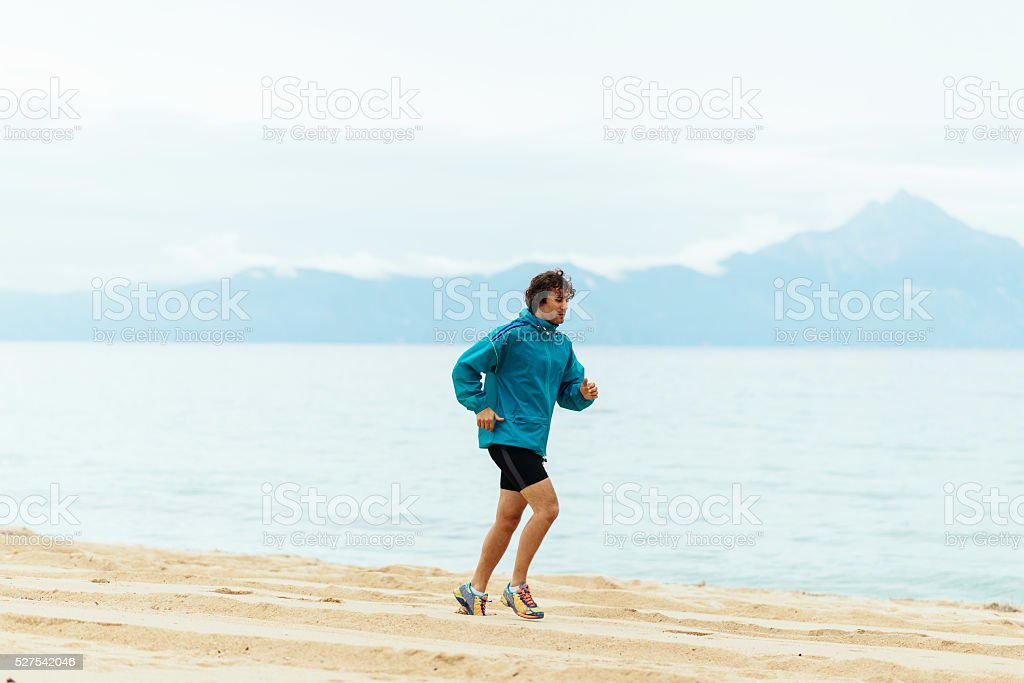 Using summer seaside holiday for staying fit and strong stock photo