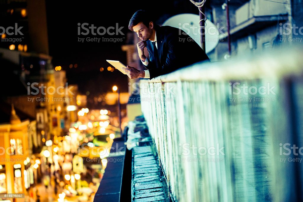 Using tablet at night stock photo