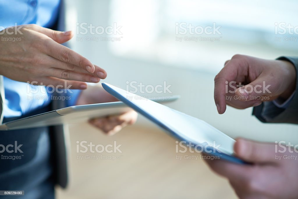 Using tablet computers stock photo