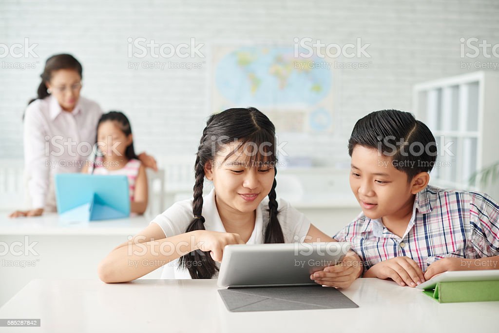 Using tablet in class stock photo