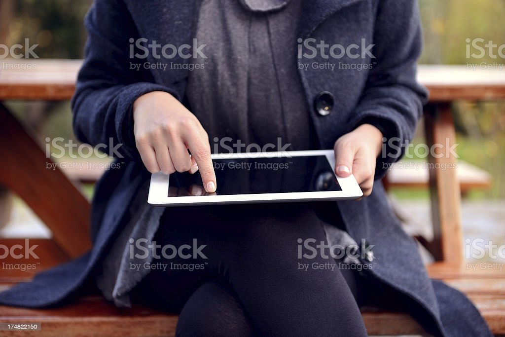 Using tablet pc in park royalty-free stock photo