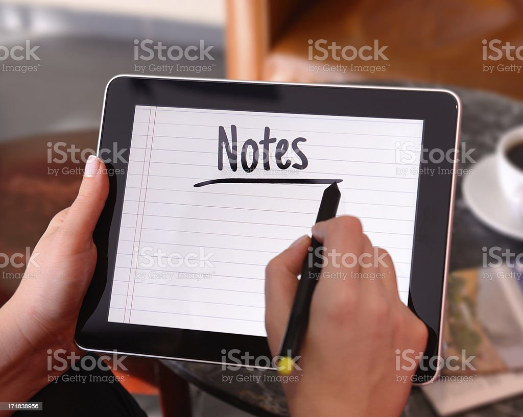 Using tablet pc with digitized pen royalty-free stock photo