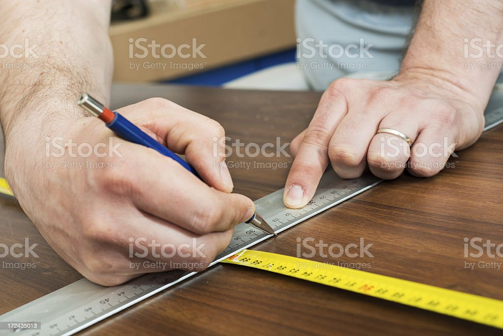 Using tape measure royalty-free stock photo