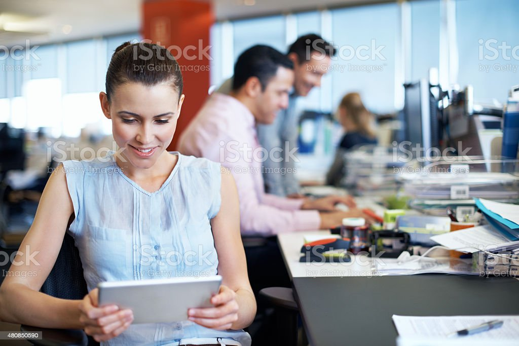 Using technology to her advantage in the workplace stock photo