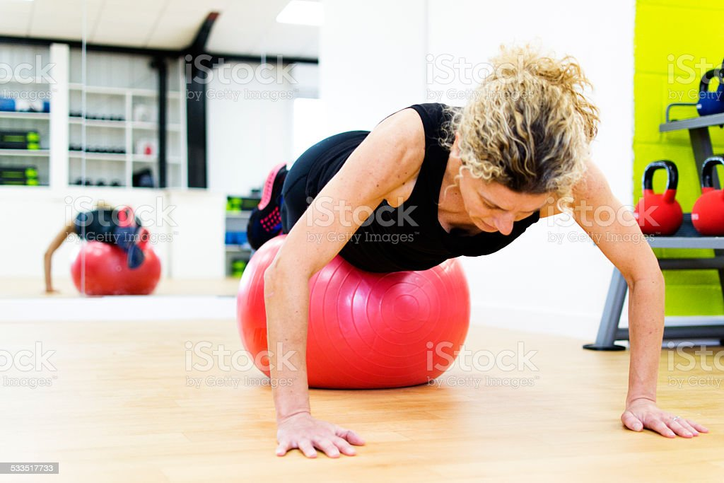 Using the fitness ball stock photo
