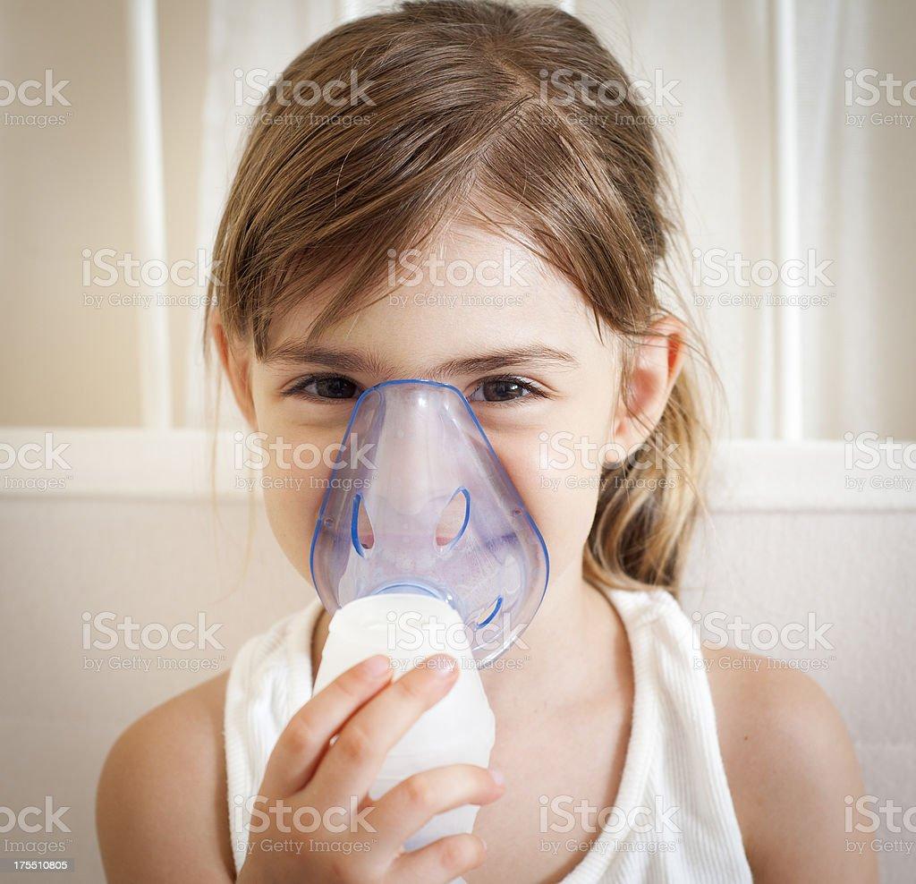 Using the inhalation mask stock photo