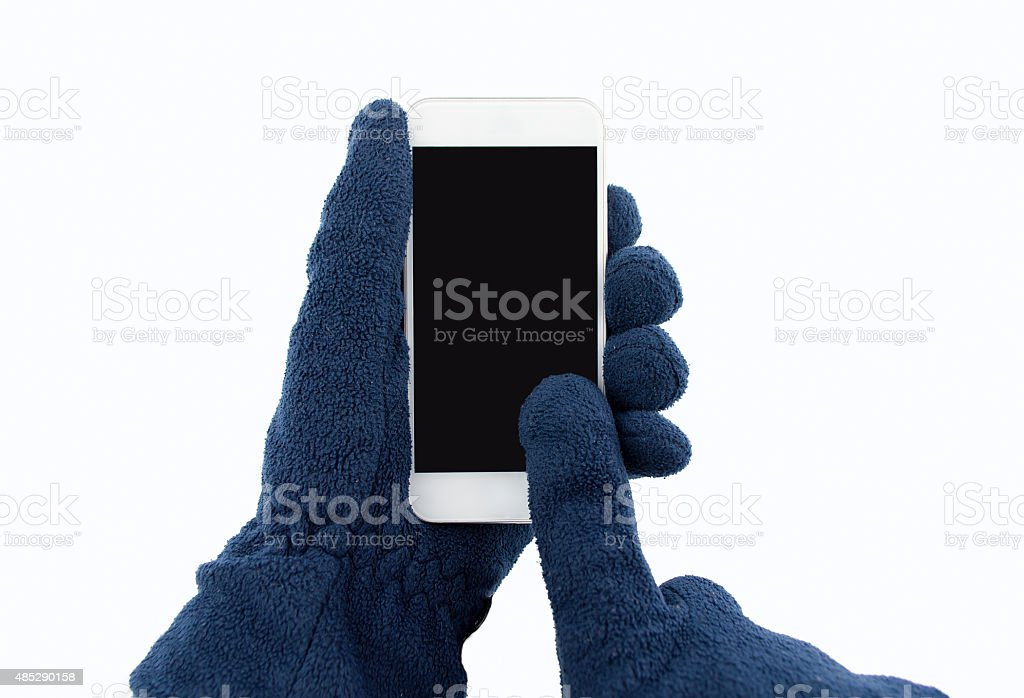 using the smartphone with gloves stock photo