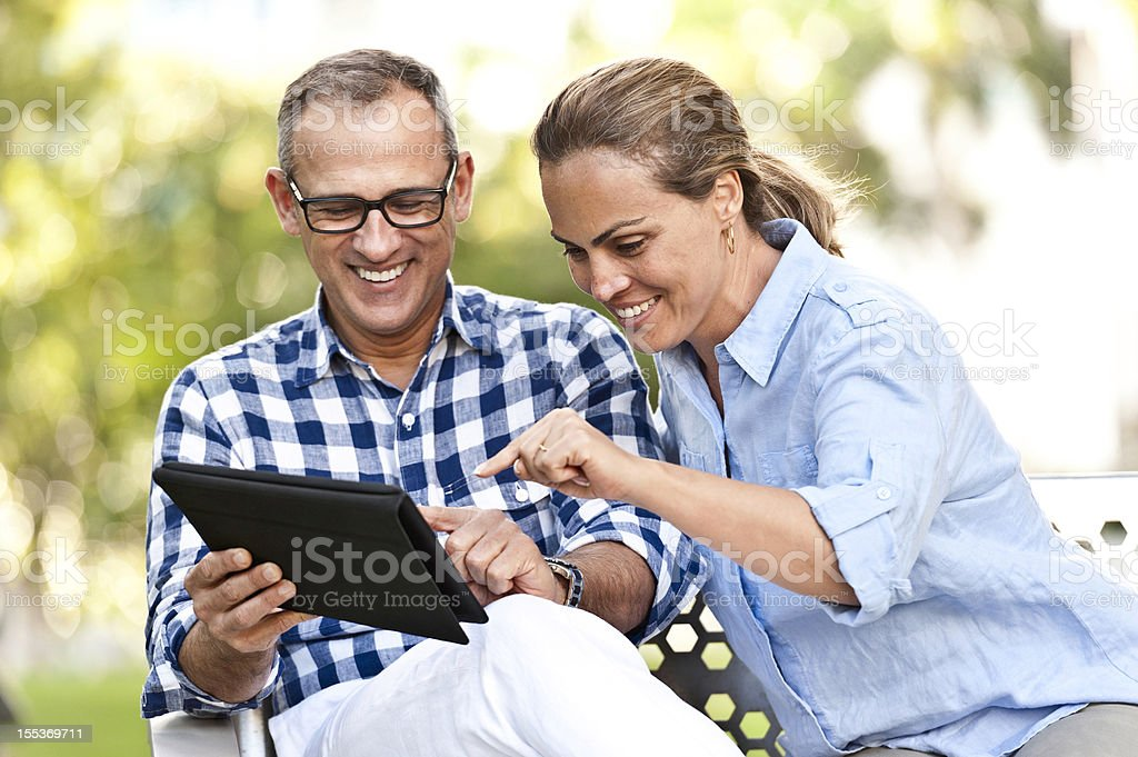 Using their Tablet PC stock photo
