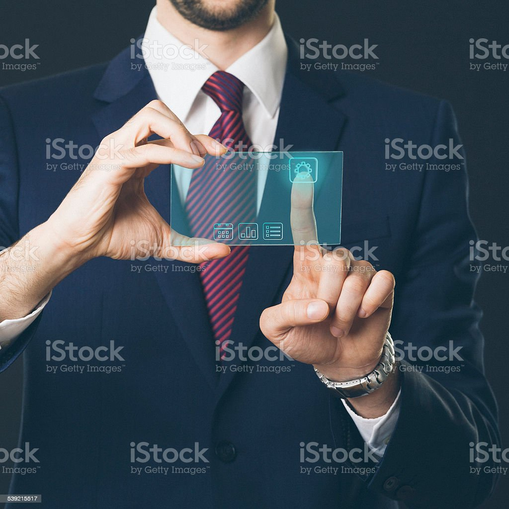 Using touch screen high tech phone stock photo