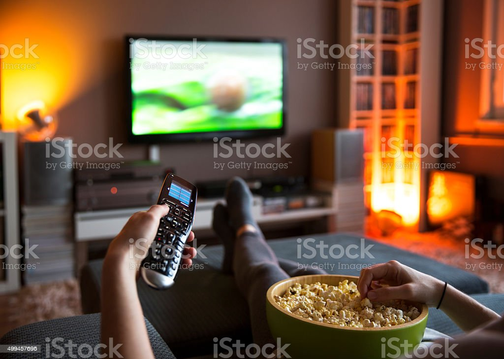 Using TV remote control stock photo