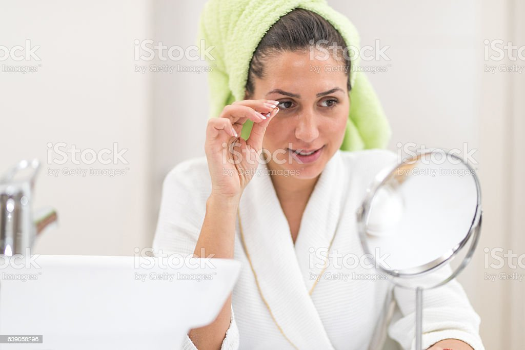 Using tweezers stock photo