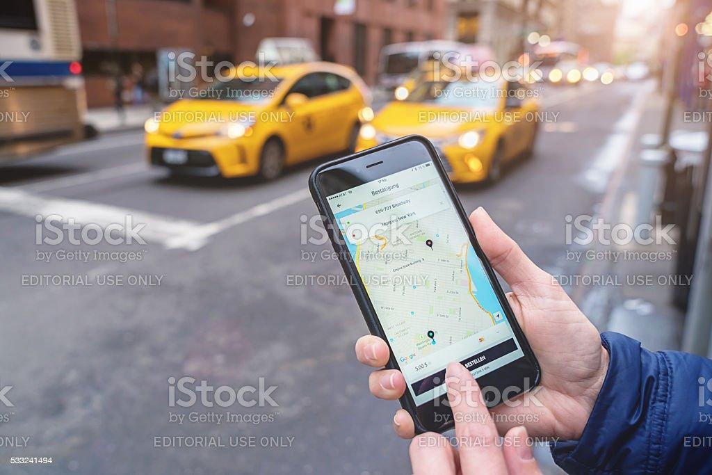 Using Uber Taxi App New York City stock photo