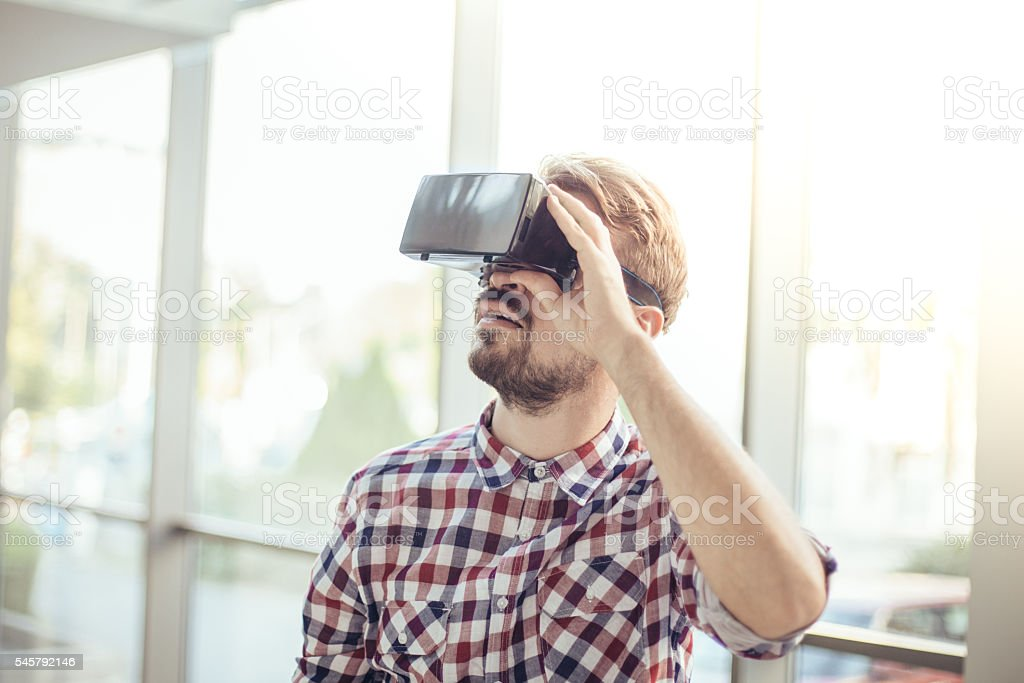 Using virtual reality headset stock photo