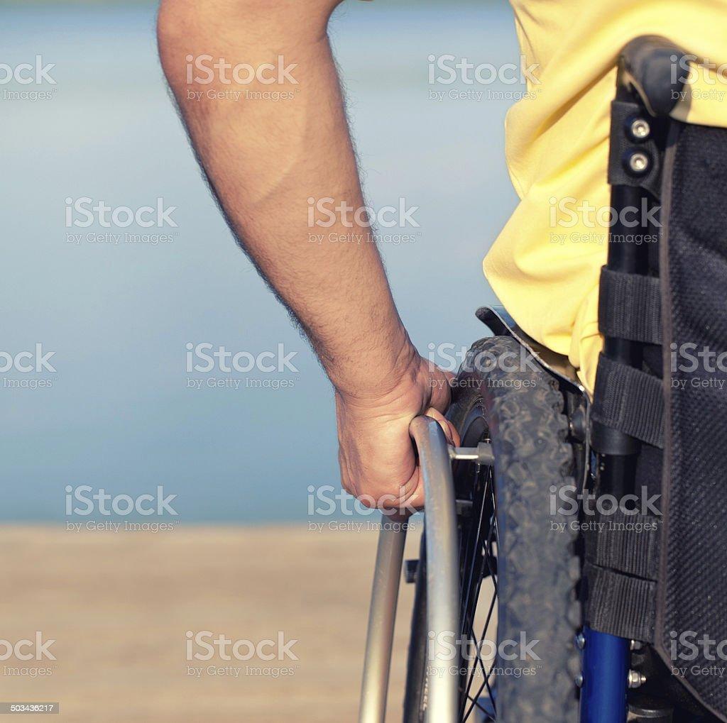 using wheelchair stock photo