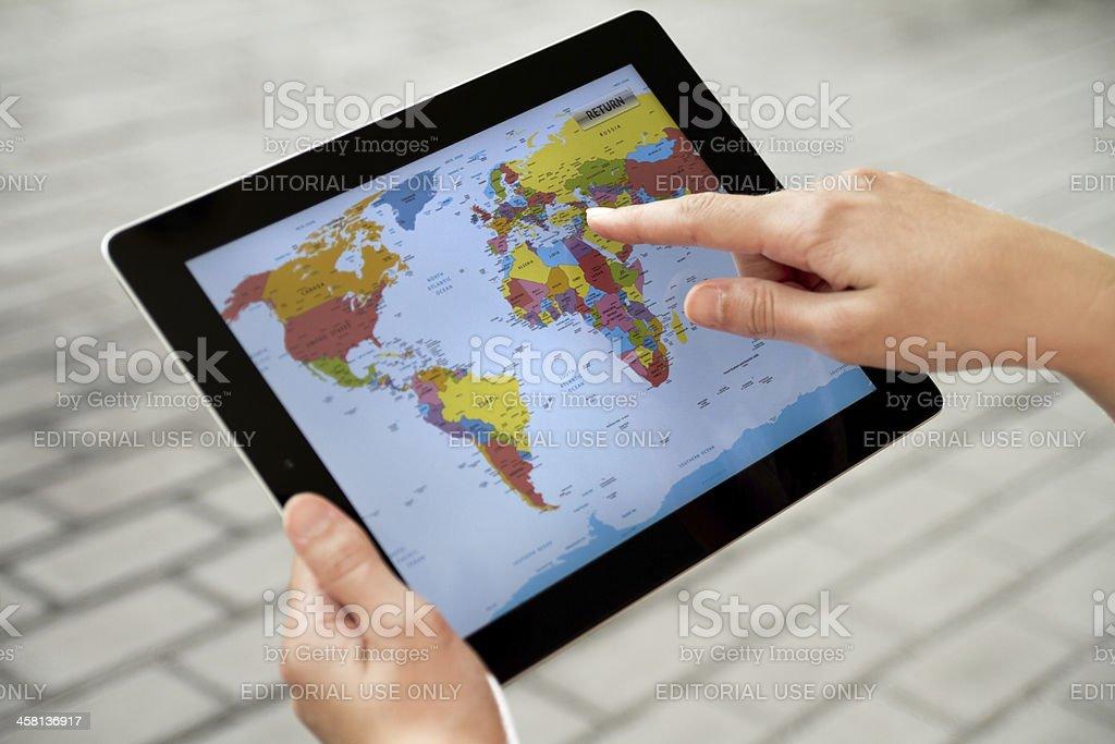 Using World Map on Apple Ipad2 royalty-free stock photo