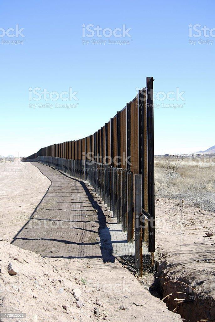 US-Mexico border fence close-up stock photo