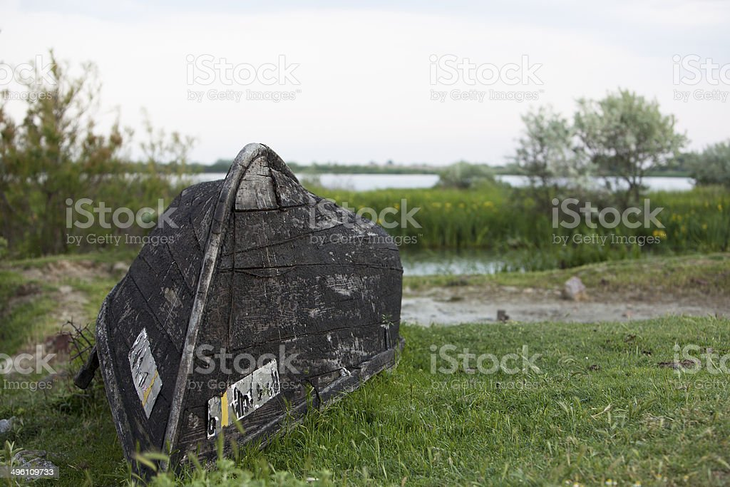 Uspide old wooden boat stock photo